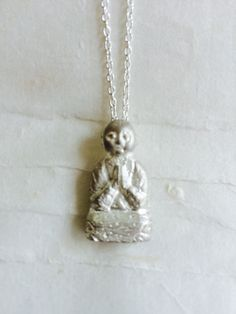 Specially ordered, Sitting Jizo in sterling silver. He was made to reflect my first Jizo statue, from the Edo Period in Japan. $150