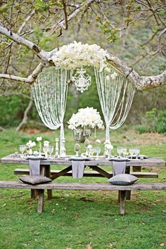 bohemian, chic, outdoor, wedding, decor, inspiration, reception, - Highlight the top table with bead curtains and a chandelier.