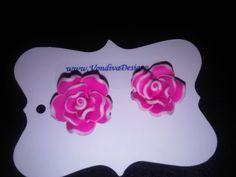 Pink floral resin earrings. $15