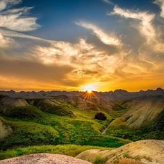 "Discover the #Badlands in #SouthDakota. Badlands #NationalPark (@badlandsnps) protect rugged buttes, pinnacles and spires surrounded by a mixed-grass prairie. William Green captured this jaw-dropping shot after spending a week at the park. Of the experience, he says, ""As evening turned to dusk, and the sun hit the horizon, I was greeted by the most stunning sunset I have ever seen: lighting the valley in an almost mystical or magical way."" Photo from www.sharetheexperience.org."