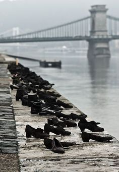 During WWII, Jews in Budapest were brought to the edge of the Danube, they were ordered to remove their shoes, and shot, falling into the water. 60 pairs of iron shoes now line the river's bank, a ghostly memorial to the victims. The memorial entitled ''Shoes on the Danube Promenade'' is by Can Togay and Gyula Pauer.