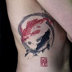 Brush Circle Fishes Tattoo on Ribs