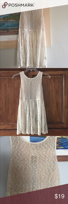 Boutique lace tunic Lovely lace tunic with sheer textured shimmer bodice. Cream color with tiny bit of shimmering gold thread in the top part. No visible signs of wear except a bit of yellowing on the inside collar (from my self tanner) but will not show when worn. See pics. Brand is Lily White. Bought from a beach boutique in Hermosa Beach. Tops Tunics