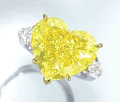 heart diamond Rings | ... carats Fancy Vivid Yellow Diamond mounted in Gold and Platinum Ring