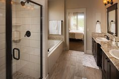 Master bathroom tile shower and tub create a spa like atomsphere.