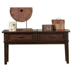 Bring rustic appeal to your living room with this wood console table, showcasing a metal-inset top with nailhead trim. Stack photography books on top and sto...