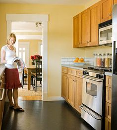 Yellow walls & wood cabinets, with white counters/back-splash & dark floors? Kitchen Design Gallery, Kitchen Remodel, Kitchen Redo, Cabin Kitchens, Kitchen Layout, Galley Kitchen Design, Kitchen Design, French Country Kitchens, Galley Kitchen Layout