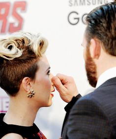 Scarlett Johansson has her nose pinched by Chris Evans as they attend 'The Avengers: Age Of Ultron' European premiere at Westfield London on April 21, 2015 in London, England.