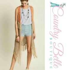 Free Spirit Fringe Vest Cardigan You'll be feelin groovy in this mocha hippie crochet long fringe vest  Cardigan.  It's your bohemian free spirit yearning to be free. Crochet sleeveless vest With Fringe bottom 65% Cotton 35% Polyester Sweaters Cardigans