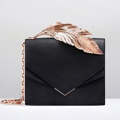 The perfect evening bag, the 'Alina' Clutch in nightfall Napa with rose gold feather. Now available to buy online at www.ralphandrusso.com #ralphandrusso #couture #accessories #handbag #clutchbag #alinaclutch #alinabag