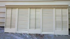 Repurposed shutters headboard -- I like capping it with crown molding.