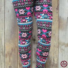 Bright, bubbly colors and happy hearts cover these leggings from head to toe. Know what that means? You can match them with just about anything! Our baby pink coffee and wine tunics would bring out the bubbly pinks on these leggings perfectly, or you can grab one of our cat or dog mama tanks to show the world who has your heart this holiday season.
