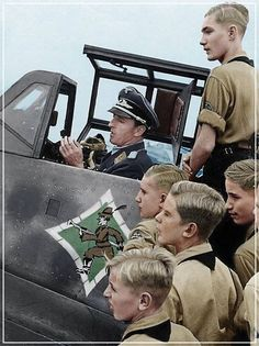 Hitler Youth boys receive a lesson by Luftwaffe ace, Hermann Graf during a day at the airfield. Luftwaffe, Ww2 History, Military History, Germany Ww2, Military Photos, Fighter Pilot, German Army, World War Ii, Wwii