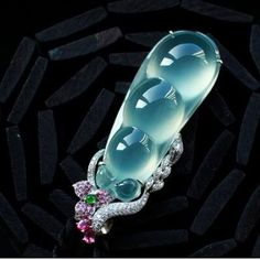 Carved jadeite, pink sapphires, Emerauld and diamonds
