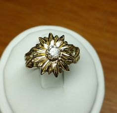 Sunflower engagement ring by jasmeenkaur on Etsy https://www.etsy.com/listing/255016160/sunflower-engagement-ring