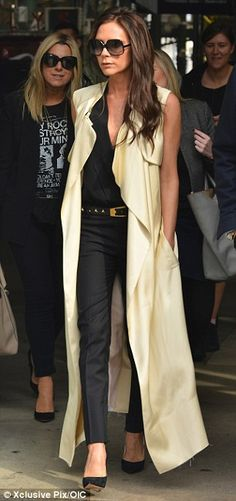 Fall #streetstyle | Victoria Beckham in a Victoria Beckham sleeveless long jacket, black blouse and skinny pants