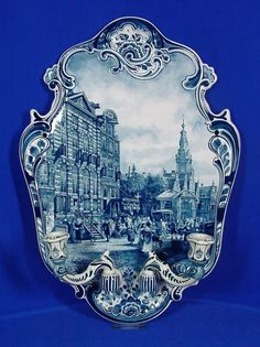 Large Delft plaque with candlesticks of Amsterdam Rembrandt house