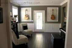 I've just created a bright inspiration room, just thought of hanging the acoustic and electric. I think these frames of book pages/newspapers to mount the guitars over looks cool!