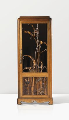 EMILE GALLÉ ARMOIRE AFRICA, 1903 'AFRICA', AN EXOTIC WOOD ARMOIRE, WITH MARQUETRY AND MOTHER-OF-PEARL INLAY, BY EMILE GALLÉ, 1903.