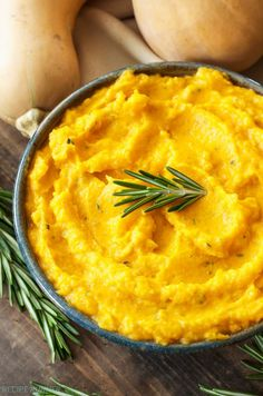 Mashed Butternut Squash with Goat Cheese and Rosemary - Goat cheese and fresh rosemary and richness and a slight piney flavor to mashed butternut squash. A great alternative to potatoes!
