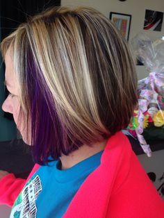 Just a pop of purple! Peek a boo purple with blonde highlights. Longer angled bob. Salon A Go-Go