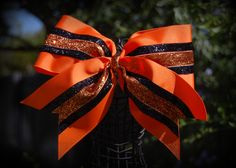 orange and black cheer bow.  See more on Facebook at Ribbons and Bows Oh My or on our website at ribbonsandbowsohmy.wix.com