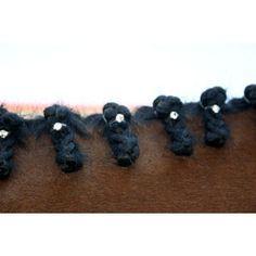 Pony Bling; www.ponybling.com  Clear Swarovski mane bling bands have a lot of fire on a black mane.