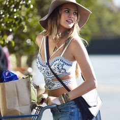 brown floppy hat, the jet set diaries EMPERORS CROP TOP, high waist denim shorts or mother THE BIG MINI A-LINE SKIRT, Bcbgeneration THE LANA SUEDE SHOULDER BAG - all from Revolve clothing