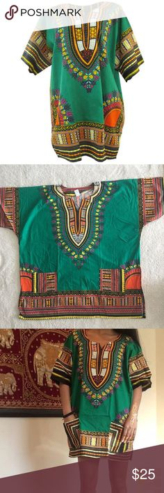 Green Dashiki 100 cotton!  Made in Thailand, however purchased in Nigeria and 100% authentic! (Super popular in W. Africa and abroad) This dashiki is unisex and one size fits most. Therefore it will be an oversized style for those who are extra small to medium! Pair it with a belt, over the knee boots, wear it as a top, a dress, or a tunic. So many style options!  Length: 29.5 inches and bust: 59 inches  No trades, please! 0001181700ng dashiki Tops