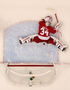 Petr Mrazek Photos Photos - Petr Mrazek #34 of the Detroit Red Wings makes a second period save while playing the Tampa Bay Lightning in Game Six of the Eastern Conference Quarterfinals during the 2015 NHL Stanley Cup Playoffs at Joe Louis Arena on April 27, 2015 in Detroit, Michigan. Tampa Bay won the game 5-2 to tie the series 3-3. - Tampa Bay Lightning v Detroit Red Wings - Game Six