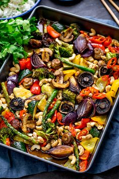 This spicy dish ofAsian Mushrooms incorporates a rainbow of veggies! All cooked together on one tray in the oven. It totally hits the spot for a healthier takeout alternative. A great Meatless Monday idea. #vegetariandinner #vegetarianrecipe #onepan #sheetpandinner #onepot #asian #asianvegetables #easyvegetariandinner