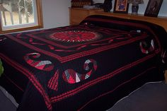 Mariner's Compass quilt finished and on the bed | pinned by haw-creek.com