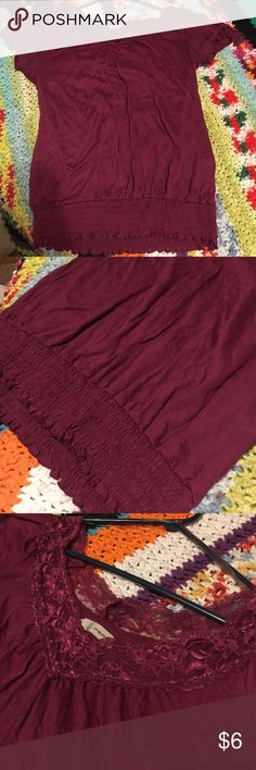 Maurice's Lacey top Very nice Maurice's maroon color lace trimmed top. Elastic at the bottom. I do have a bulldog and try hard to remove any hairs that may be on this item. Maurices Tops Tees - Short Sleeve