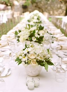 White floral centerpieces / floral by Mindy Rice, design by Lisa Vorce, photo by Aaron Delesie