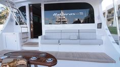 Hatteras GT Here is a view of the fighting chair and mezzanine seating. Notice the rod holders g. Hatteras Yachts, Boat Interior, Interior Design, Rod Holders, Chair, Angles, Ladder, Bridge, Display