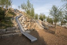 """The Hills"" by West 8 Set to Open on Governors Island,Slide Hill features four slides, including the longest slide in New York City (57 feet long). Image © Tim Schenck"