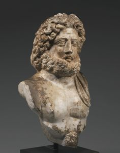 A Marble Bust of Zeus, Roman Imperial, Eastern Mediterranean, circa 2nd Century A.D.