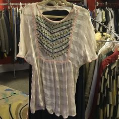 Crazy cool FREE PEOPLE Blouse. Size Medium So beautifully unique blouse by FREE PEOPLE. From my own personal collection. Size Medium. Excellent pre owned condition. All my items are sold in my store as well and can be sold and removed from this listening without notice. So get it quick  Free People Tops Blouses