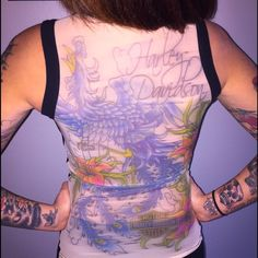Harley Davidson Tattoo Tank top Harley Davidson with mesh like panty hose backing made-to-look like tattoo on back! Cotton front. Beautiful shirt. LOVE IT! I just don't ride anymore. Very flattering. No damages. Worn 3 times. Harley-Davidson Tops Tank Tops