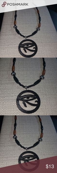 Men Eye of Ra Necklace Men Ancient Egyptian Eye of Ra Black Wood charm on a leather rope with lucite, Silver  pewter and wood beads.  24 inches in length.   Also has adjustable links if you want to wear it longer in length. Accessories Jewelry