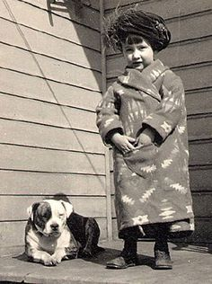 A little cutie in her beacon robe with pitbull pal.