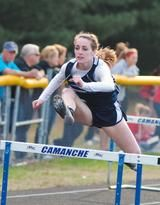 Northeast's Morgan McAleer competes in the shuttle hurdle relay Tuesday in the Class B portion of the Camanche Indian Girls Relays. McAleer, who also won the 400-meter hurdle event, helped the Rebels win the shuttle hurdle event while Preston took second. / Clinton Herald