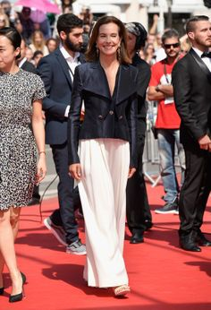 Carole Bouquet in a silk Chanel cruise 2014 jacket, Chanel pants and heels and Chanel Joaillerie jewelry cannes - 2014