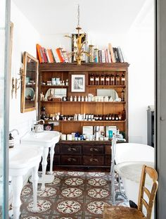 COCOCOZY: Eclectic Parisian Master Bath with cement tile floor.