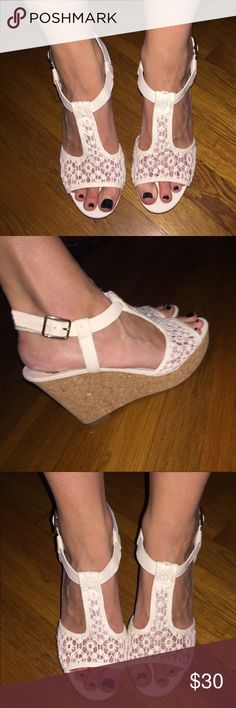 Size 8 Fergalicious cream wedges Only worn once at a wedding for 30 minutes. Fergalicious brand by Fergie. Wooden cork board like wedge, front of shoe where toes sit is cloth. See through lace top. Only discrepancy with shoe is black spot on left wedge. Fergalicious Shoes Wedges