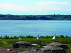 The earthlodge Village at New Town is on the shores of Lake Sakakawea.