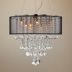 """Jamie, I think this is the one for the dining room... Brushed nickel frame. Black sheer shade. Glass crystal accents. Includes fourteen 25 watt G9 halogen bulbs. Fixture size is 22"""" wide and 20"""" high. Shade size is 22"""" wide and 7"""" high Canopy is 5"""" wide. Includes 12 feet adjustable cable and wire. Hang weight is 15 pounds."""