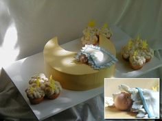 A precious sleeping sugar baby - This baby shower cake was made to match the new arrival's nursery theme of moons and stars. It features a sculpted crescent moon cake accented with a hand sculpted sleeping sugar baby and cupcake 'clouds' accented with sugar stars.