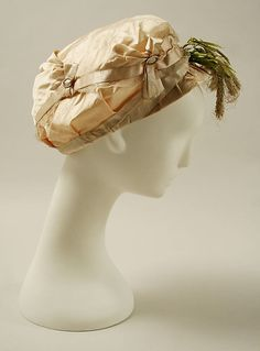 Hat ca. 1800 Culture: French Medium: silk, raffia, metal Dimensions: Length (CF to CB): 16 in. (40.6 cm)