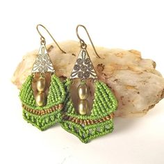 Light green and brown macrame and brass beads hang from a gold toned pewter filigree triangle. The ear wires are hand made from solid brass.    These